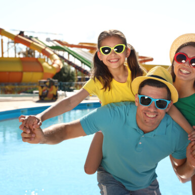 Happy family at water park. Summer vacation